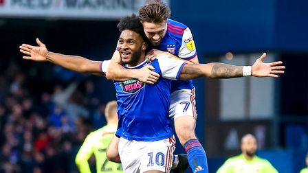 Ellis Harrison celebrates with team-mate Gwion Edwards after scoring against Sheffield United - his