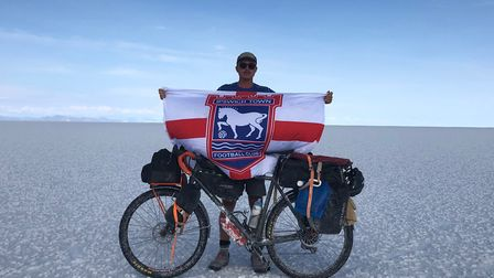 Roo Clark from Stutton, with his Ipswich Town flag at the Salar de Uyuni in Bolivia - the biggest sa
