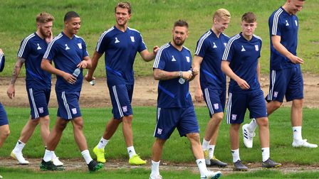 Luke Chambers leads the Ipswich Town players out for the first full day of pre-season training. Phot