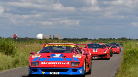 Ferocious Ferraris at the Heveningham Hall 2019 event with Sizewell B in the distance. Photo: Tim Sc