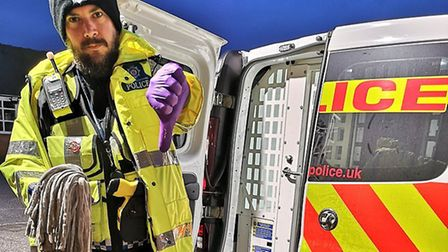 An officer cleaning urine off the British Transport Police van in Colchester Picture: BTP ESSEX