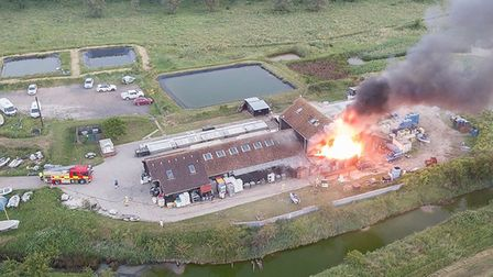 Six fire engines were sent to the scene of the Colchester Oyster Fishery fire in Mersea Picture: KEV