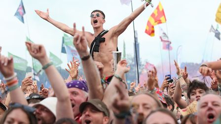The crowd watching Liam Gallagher performing on the Pyramid Stage during the Glastonbury Festival. P