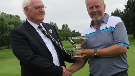 Peter Revell of Bungay and Waveney Valley Golf Club receives the Geoffrey Barnard Bowl from Suffolk
