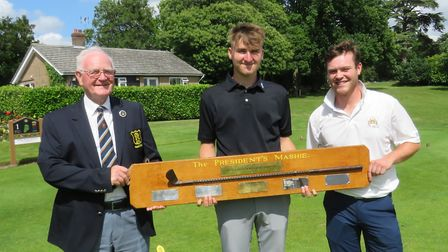 George Fricker (centre), winner of the Suffolk Matchplay Championship, the President's Mashie, with