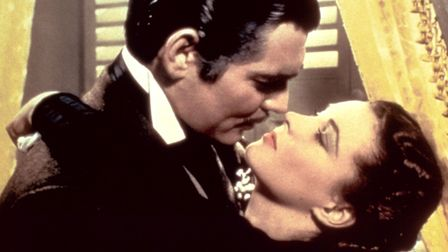 What a kiss... Rhett Butler (Clark Gable) and Scarlett O'Hara (Vivien Leigh) in Gone With The Wind.
