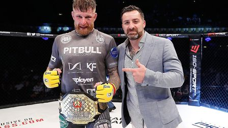 Colchester's James Webb with Cage Warriors president Graham Boylan after retaining his middleweight