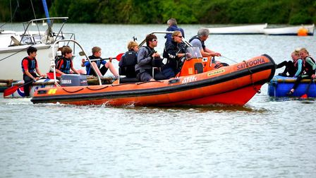 The raft racers getting towed back during last year's Woodbridge Regatta and Riverside Fair Photo: W