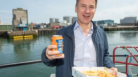 One of the two men shortlisted for leader of the Conservative Party enjoying fish and chips and a ca