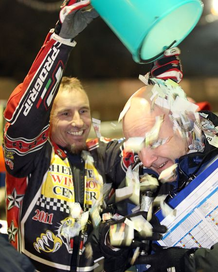 Shane Parker tips a bucket of paper over Kevin Long at Foxhall in 2011. Picture: STEVE WALLER