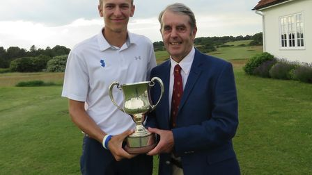 Gregor Tait receives the Seaton Robson Trophy from Aldeburgh club captain Antony Dearden. Photograph