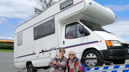 Tracey Salmon, her mother Marilyn and their dog Dolly next to their broken down motorhome. Picture: