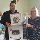 Hughes Electrical's Nick Boast hands over a printer and CD player to Eye Opportunity Group play lead