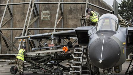 The wings are re-attached to the fuselage of a Tornado Picture: RAF HONINGTON