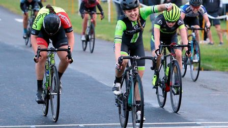 Gemma Melton (Pedal Power Ipswich) wins from Sophie Holmes (left) and Jodie Taylor at Trinity Park.