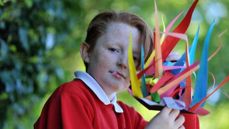 Luke with his paper sculpture Picture: SARAH LUCY BROWN
