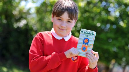 Kyle with his hand made book Picture: SARAH LUCY BROWN