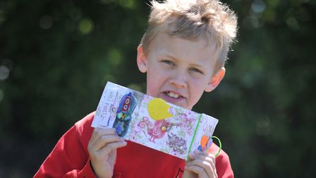 Tobias with his hand made book Picture: SARAH LUCY BROWN