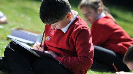 Children at Snape Primary School enjoying their art class outside in the sunshine Picture: SARAH LU