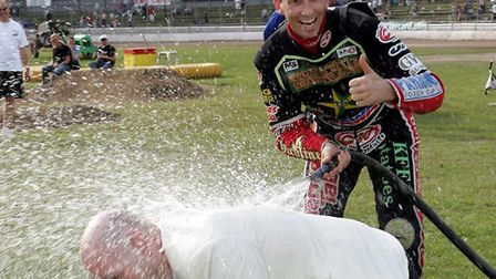 Presenter Kevin Long gets a soaking from Shane Parker - one of Kevin's all-time favourite Ipswich Wi
