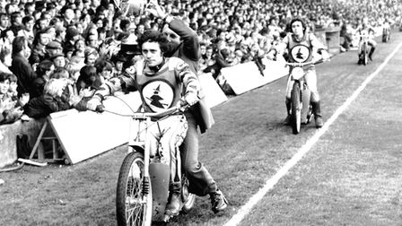 John Louis (on bike), with team boss Ron Bagley on the back, as the Witches show off the Championshi