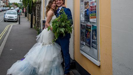 Hayley Evenett and fellow actor James Ducker outside The Fisher Theatre, Bungay where they got marri