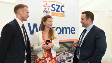 Josh Clarke-Davis, left, and James Gowing, right, from Dalcour Maclaren with Beth Winstone of the Si
