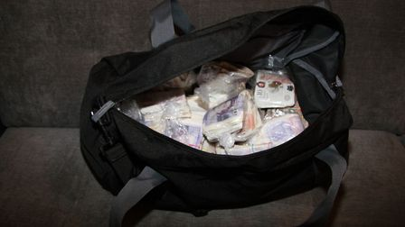 A bag was found in one property containing approximately £50,000 cash Picture: ESSEX POLICE