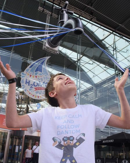 Felix Wooltorton, 11, waiting for the water to come out of the giant tap at the H20MG water festival