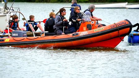 The raft racers getting towed back during last year's Woodbridge Regatta and Riverside Fair Photo: