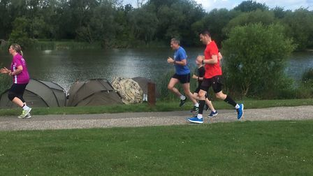 Runners approach the finish to last Saturday's Basildon parkrun, beside the fishing lake in Northlan