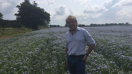 Natural England chair Tony Juniper in a linseed crop field at EJ Barker & Sons family farm Picture: