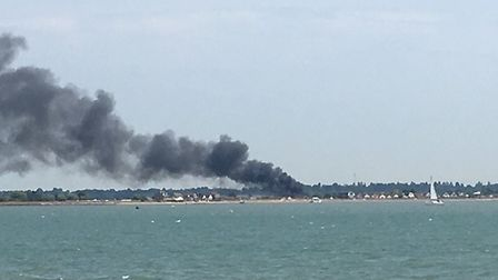 The fire in St Osyth is visible from miles along the coast, with black smoke billowing from the site