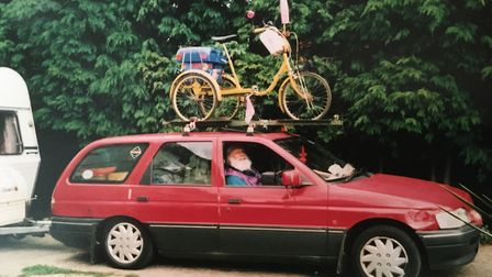 All ready for the annual pilgrimage to Eastbridge, maybe: loaded-up estate car, caravan and tricycle