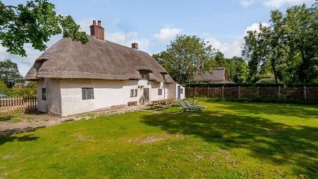 The planning consent covers a double garage and workshop within the grounds of Stackwood Cottage. Pi