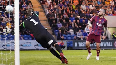 Dean Gerken is beaten as James Norwood scores his third and Town's fourth in the Colchester United m
