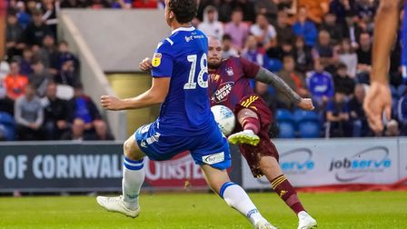 James Norwood thrashes home his second in the victory over Colchester. Picture: STEVE WALLER WWW