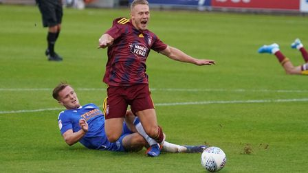 Danny Rowe is brought down in the area, ahead of Town's penalty in the first half. Picture: STEVE W
