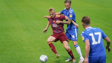 Flynn Downes on the ball with Ben Stevenson in close attendance during the first half. Picture: STE