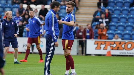 Luke Garbutt talking with Town assistant manager Stuart Taylor ahead of the match. Picture: STEVE W