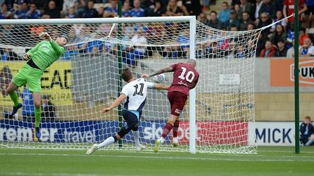 James Norwood scores but the goal is disallowed for hand-ball at Cambridge Picture Pagepix