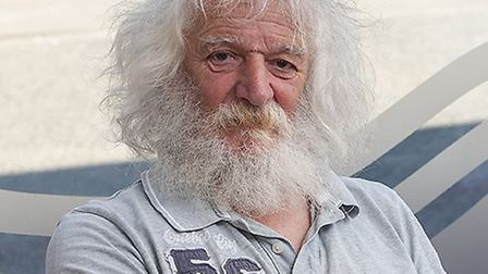 Mervyn Tokley with his impressive hair and beard before the big shave Picture: ALLY BAIN
