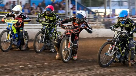 From the left, Kyle Howarth, Danny King, Sam Masters and Richard Lawson race towards the first bend