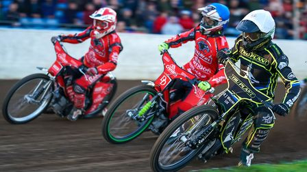 Danny King on the inside of Charles Wright and Ben Barker and on his way to a new Peterborough track