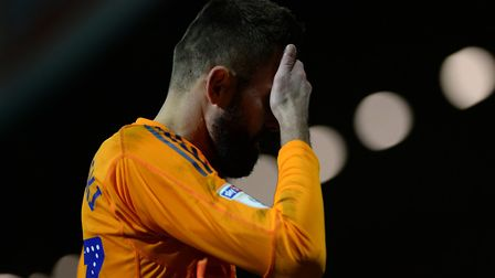 Bartosz Bialkowski leaves the pitch at Griffin Park after a defeat against Brentford. Photo: Pagepix