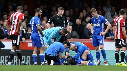 Luke Chambers receives treatment after his heavy collision with keeper Bartosz Bialkowski at Brentfo