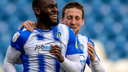 Bags of experience: Frank Nouble, celebrating a goal against Newport, with defender Tom Eastman. Bot