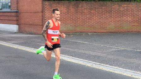 Danny Rock approaches the half-way mark on his way to victory at the Ipswich Twilight 10K. Picture:
