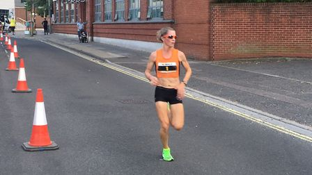 Helen Davies, on her way to retaining her ladies' title at the Ipswich Twilight 10K, in the colours