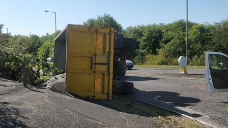 The A1017 is closed after a tractor spilt six tonnes of rapeseed. Picture: HAVERHILL POLICE